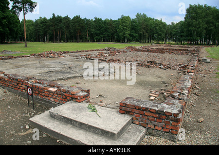 The ruined remains of Crematorium IV at the former Nazi concentration camp at Auschwitz Birkenau. - Stock Photo