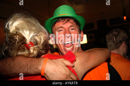 Dutch fans celebrating Holland's 1-0 victory over Serbia Montenegro in 2006 World Cup, De Hems Bar, London - Stock Photo