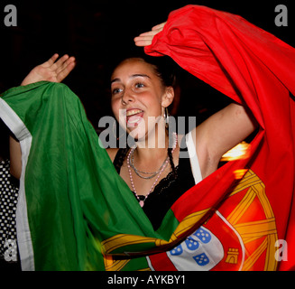 Portuguese fans celebrating 2006 World Cup Finals 1-0 win vs Angola, Estrela Restaurant, Stockwell, London - Stock Photo