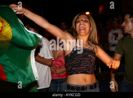 Portugal fans celebrate 1-0 win vs Angola, 206 World Cup Finals, Estrela Restaurant, Stockwell, London - Stock Photo