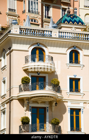 windows and balconys of an old building in Monaco - Stock Photo