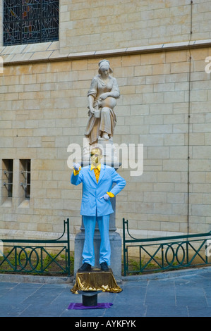 Human Statue and a real statue in Petit Ring quarter of Brussels Belgium Europe - Stock Photo