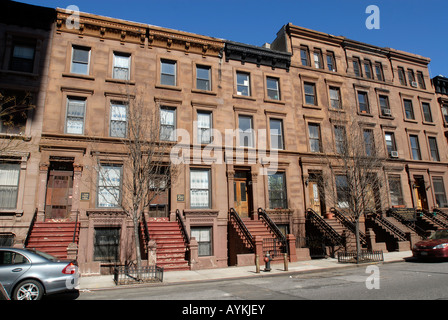 Brownstones West 126th Street in Harlem in NYC - Stock Photo