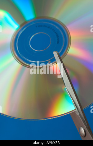 scissors cutting a cd-rom concept data security archiving destroy privacy secrecy information - Stock Photo