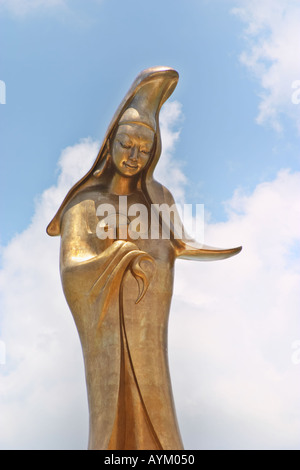 Bronze statue of the buddhist goddess of mercy Kun Iam at the outer harbour waterfront Macau China - Stock Photo