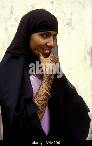Young woman of Lamu wearing the traditional black buibui head covering Kenya coast East Africa - Stock Photo