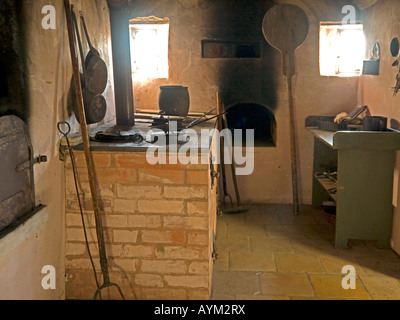 kitchen interior view in an old house with original historic interior in the Franconian open air museum - Stock Photo