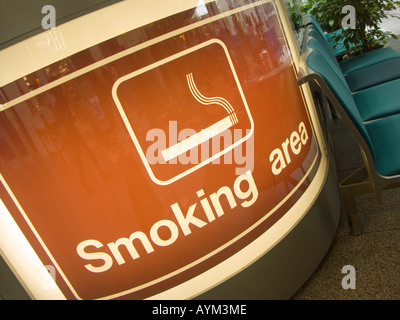 Indicating the smoking area at Southampton Airport with special ventilation and disposal features - before the indoor - Stock Photo