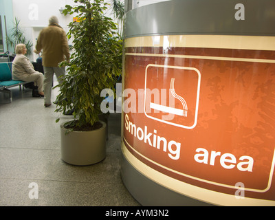 Indicating the smoking area at Southampton Airport with special ventilation and disposal features - before the smoking - Stock Photo