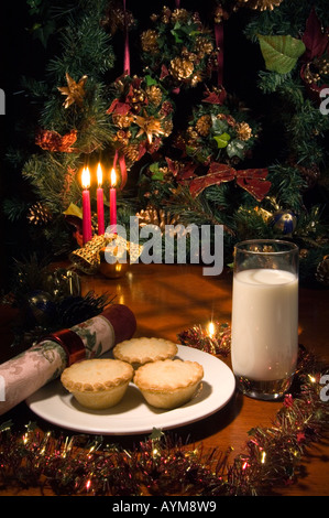 Santa's Treat for supper: Shop bought mince pies with a glass of milk - Stock Photo