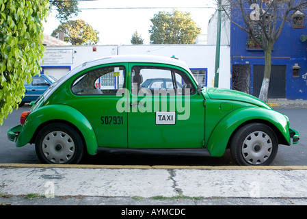 Empty Green VW Beetle Taxi parked by the curb in Mexico City - Stock Photo