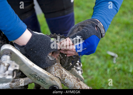 Close-up of cyclist repairing a broken chain during Mountain Bike trip in Yorkshire Dales, Great Britain - Stock Photo