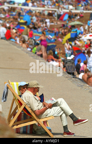 The busy scene at Paignton beach in  Devon UK - Stock Photo