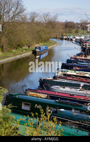 Narrow Boats moored on the Leeds and Liverpool canal at the White Bear Marina in Adlington - Stock Photo