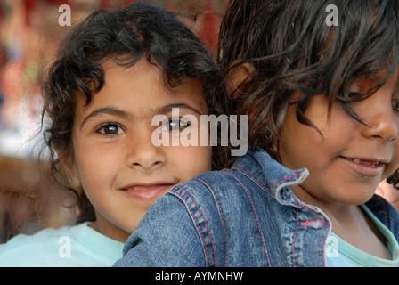 Bedouin girls in Dahab, Egypt, is having fun - Stock Photo