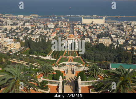 Israel Haifa Bahai gardens and shrine elevated view with terraces in frgd and city and port in bkgd - Stock Photo