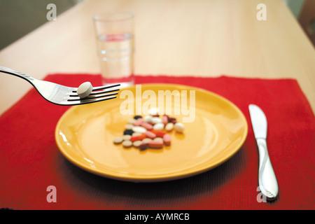 Pillen als Mahlzeit - Stock Photo
