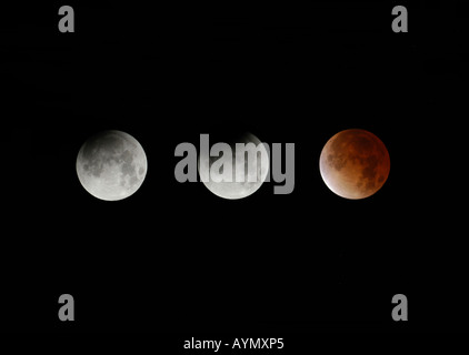 Three phases of a total lunar eclipse seen from Prague, Czech Republic, on November 8, 2003 - Stock Photo