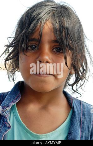 Portrait of a Bedouin girl in Dahab, Egypt - Stock Photo