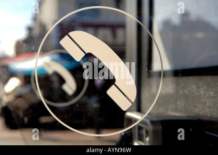 BT phone sign on the window of a telephone booth - Stock Photo
