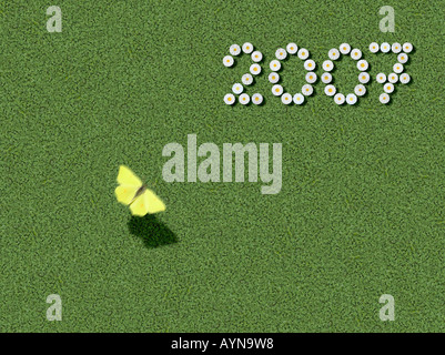 year written with flowers and flying butterfly spelled out prewritten edited - Stock Photo
