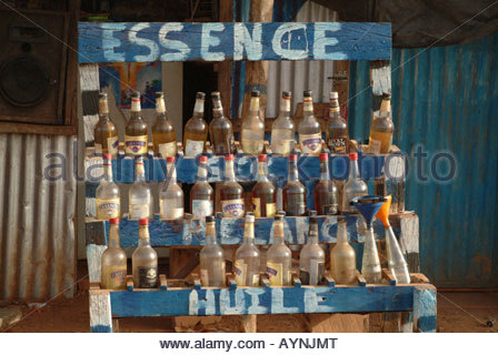 Africa, Burkina Faso, View Of Gasoline Sold By The Wine Bottle - Stock Photo