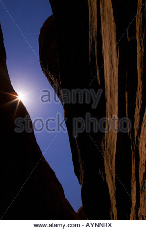 The midday sun shines through the ceiling of a slot canyon in the Grand Staircase Escalante in Utah. - Stock Photo
