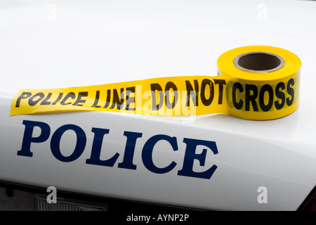 Police Car with Crime Scene Tape - Stock Photo