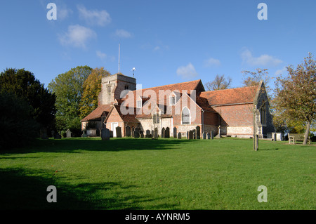View of grounds and church at Holy Trinity Parish Church,Penn on a beautiful clear day with hard shadows and blue - Stock Photo