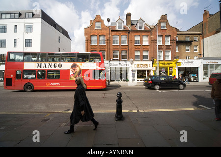 Shops and passers by in Kings Road London SW3 - Stock Photo