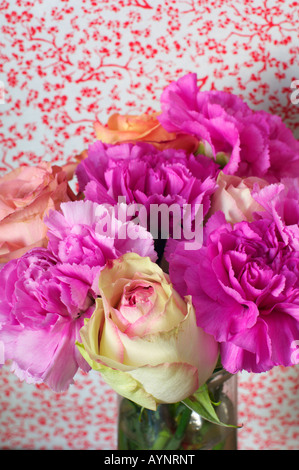Bunch of roses and peonies in a vase