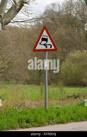 Slippery Road sign, UK. - Stock Photo