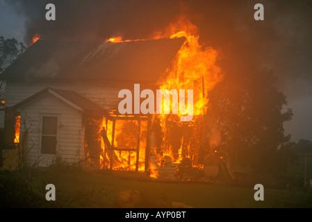 Vacant house on fire USA, by Carol Dembinsky/Dembinsky Photo Assoc - Stock Photo