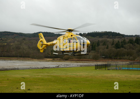 Scottish Air Ambulance helicopter taking off Lochgilphead Argyll Scotland - Stock Photo