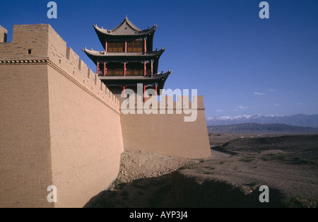 CHINA Gansu Jiayuguan Fort Western end of The Great Wall Turreted walls of castle with pagoda building and landscape - Stock Photo