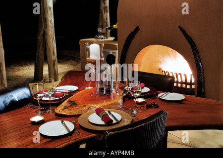 The rustic African themed table settings of the Bush Suite Okonjima Private Game Reserve Namibia - Stock Photo