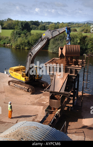 SAND AND GRAVEL IS UNLOADED AT THE CEMEX PROCESSING PLANT AT RYALL - Stock Photo
