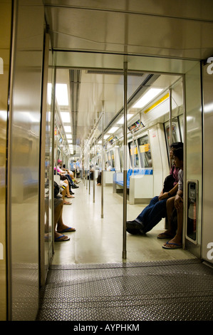 Inside view of modern subway train in Singapore - Stock Photo