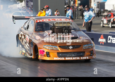 Ben Bray, leading Australian Top Doorslammer driver, performs a pre race burnout to warm the tyres - Stock Photo
