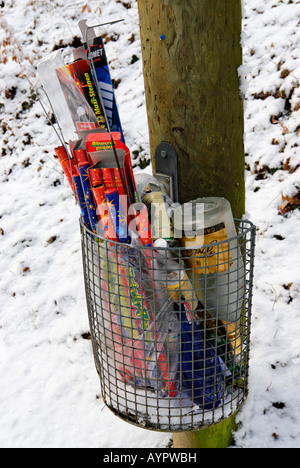 Trash bin filled with New Year's fireworks - Stock Photo