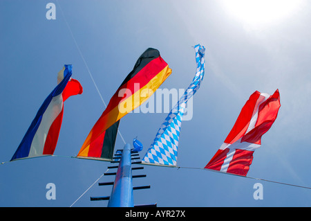 German, Bavarian, Danish and Dutch flags blowing in the wind, Chiemsee (Lake Chiem), Prien, Upper Bavaria, Bavaria, - Stock Photo