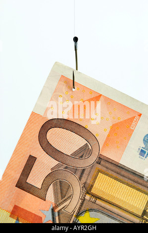 50-Euro bill hanging from a fishing hook - Stock Photo
