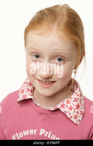 Eight-year-old girl full of expectation - Stock Photo