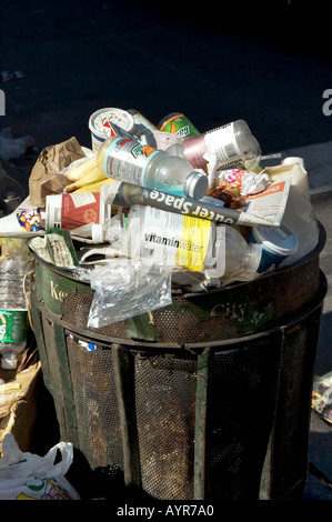 OVERFLOWING TRASH CAN IN MIDTOWN MANHATTAN NEW YORK CITY UNITED STATES OF AMERICA USA - Stock Photo
