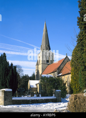 St Mary Magdelene Church in winter, Mitford, Northumberland, England, UK. - Stock Photo