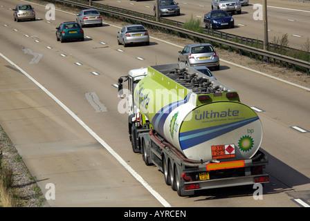BP petrol tanker lorry on M25 Motorway with Hazchem panel - Stock Photo
