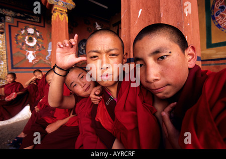 Portrait of young buddhist monks in the Paro dzong, Bhutan - Stock Photo