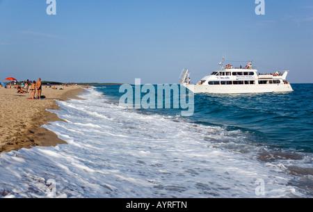 Charter boat coming in to Marina di Orosei near Orosei, Sardinia, Italy - Stock Photo