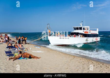 Charter boat docking on the coast, Marina di Orosei near Orosei, Sardinia, Italy - Stock Photo
