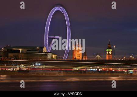 London Eye ferris wheel and Westminster Palace at dusk, London, England, UK - Stock Photo